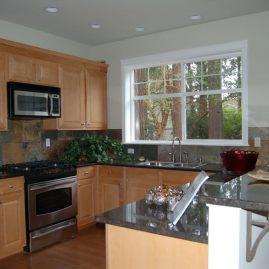 Light Wood & Dark Tiled Kitchen