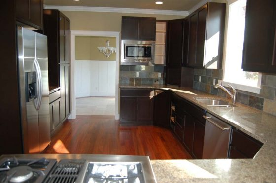 Dark Wood & Chrome Kitchen - Summa Homes