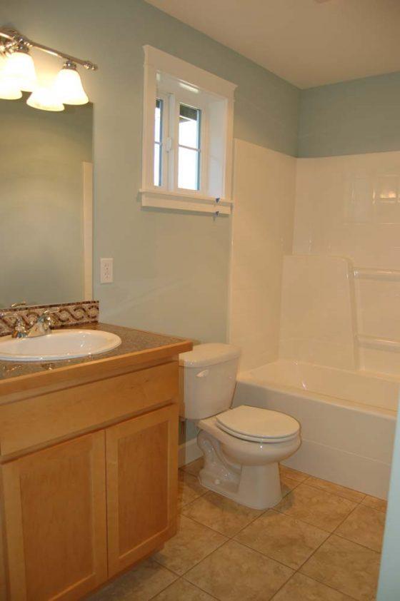 Light Wood & Tiled Bathroom - Summa Homes