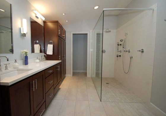 Light Tiled Bathroom With Dark Wood - Summa Homes